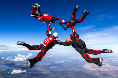 parachute jump: Skydivers in relative work  Stock Photo