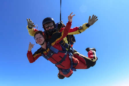 tandem: Tandem jump. The girl with the instructor in freefall. Stock Photo