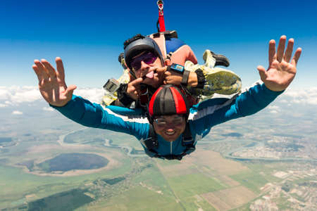Tandem jump  A student with an instructor in freefall  Stock Photo