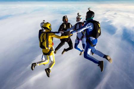 parachuting: Sports parachutist build a figure in free fall