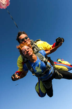 Tandem jump  The girl with the instructor in freefall  photo
