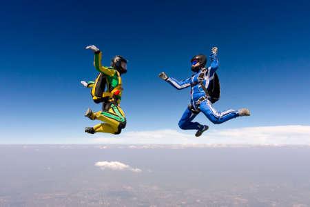 parachutists: Two parachutists girls in free fall  Stock Photo