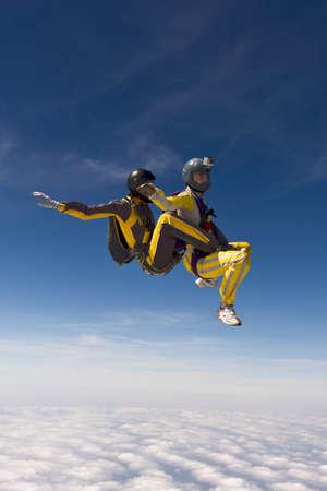 parachutists: Two parachutists girls in free fall. Stock Photo