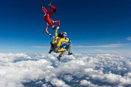 parachutists: Three parachutists freestyle