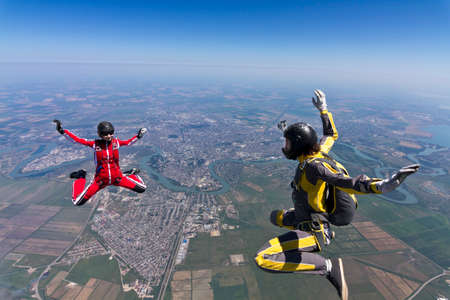 parachutists: Two parachutists girls in free fall  Stock Photo