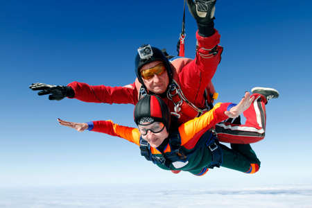 parachute jump: A tandem jump instructor and a passenger in a free fall