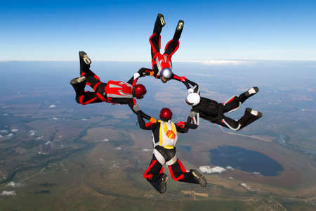 parachuting: Sports parachutist build a figure in free fall.