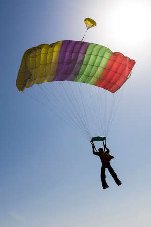 piloting: Piloting the parachute in the clouds. Stock Photo