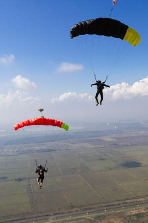 parachuting: Piloting the parachute in the clouds. Stock Photo