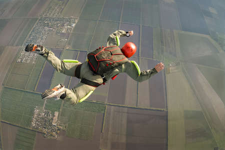 hobbies: Sportsman skydiver in free style. Stock Photo