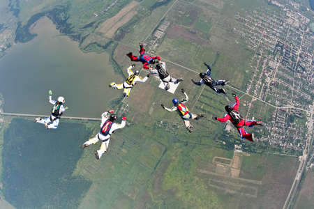 extreme danger: Group of skydivers in freefall.