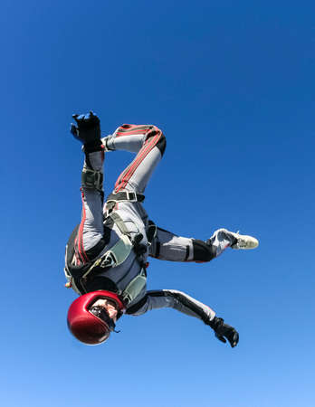 freefall: Skydiver in freefall upside down. Stock Photo