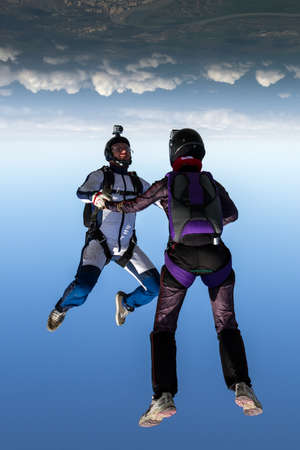 freefall: Two skydiver in freefall in the clouds. Stock Photo