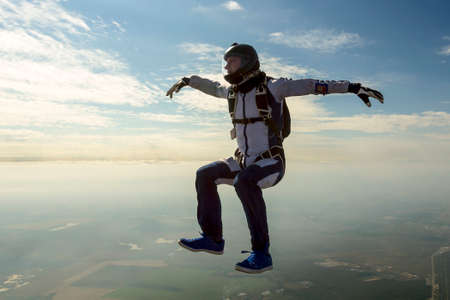 jumpsuit: Skydiver athlete performs figures in freefall.