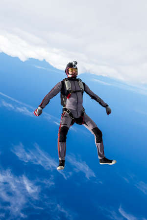 freefall: Skydiver athlete performs figures in freefall.