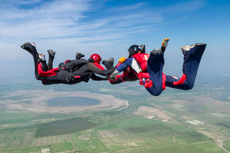 caida libre: Group collects figure skydivers in freefall. Foto de archivo