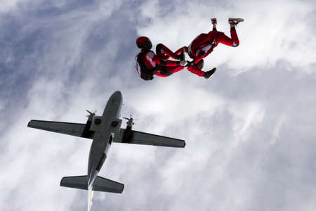 parachutists: Two parachutists jumped from a plane.
