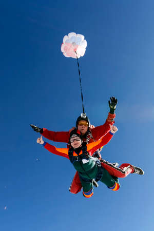 fun activity: A tandem jump instructor and a passenger in a free fall. Stock Photo