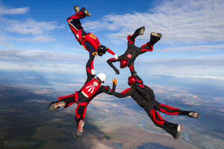extreme danger: Group collects figure skydivers in freefall. Stock Photo