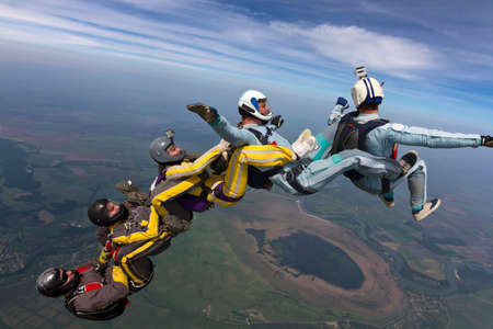 freefall: Five skydivers free-fall in the figure.