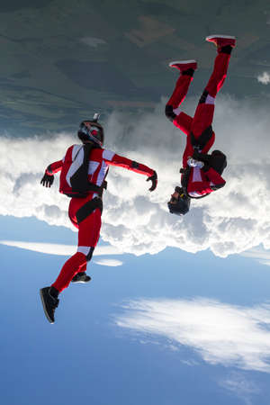 thrill: Two sports parachutist build a figure in free fall.