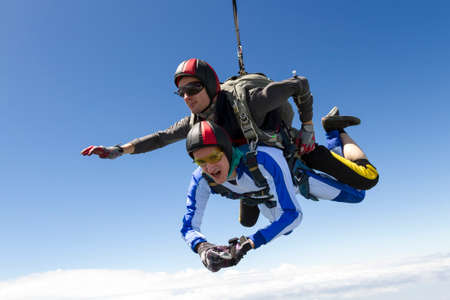 Tandem: Tandem jump. The instructor and the student in freefall.