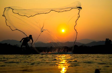 sunset Light and fishermen.