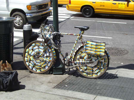 Bicycle, in New York, covered by subway tickets