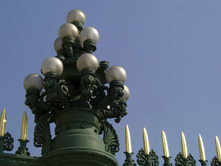 Multi-Lamp Lamppost on a Artistic Gate in the Blue Clear Daily Sky Archivio Fotografico