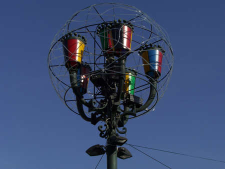 Colored artistic lamps over blue sky in Turin