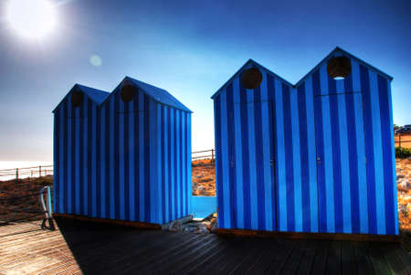 Two couples of Blue Old Style Beach Huts Archivio Fotografico