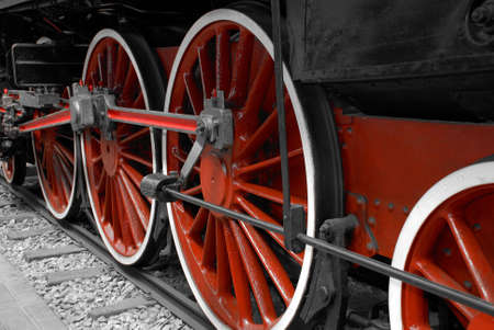 Particular of a driving wheel of a locomotive of a steam engine train photo