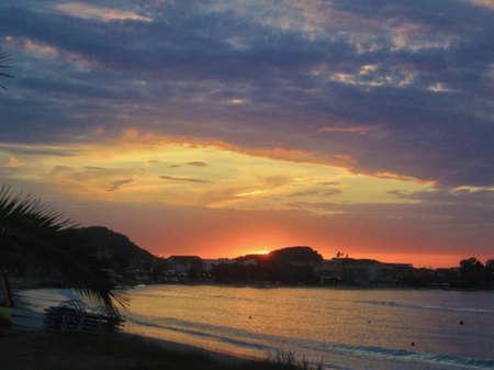sunset at long beach in sidari corfu photo