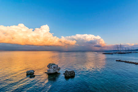 kerkyra: colored sea with rocks and sunset Stock Photo