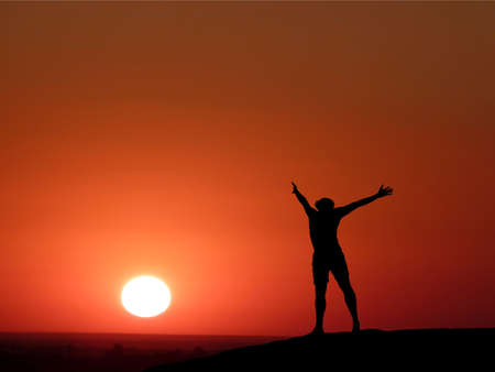 silhouette of a man at the top of the mountain against the sky Stock Photo - 10323723