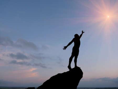 silueta de un hombre en la cima de la montaña contra el cielo Foto de archivo