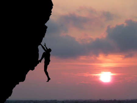 struggling: climber to conquer the peak Stock Photo