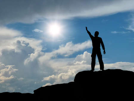 man on top of the mountain reaches for the sun Stock Photo - 10382406