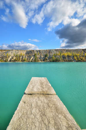 stone pier in the lake against the backdrop of the cliffs. natural composition Stock Photo - 11020312