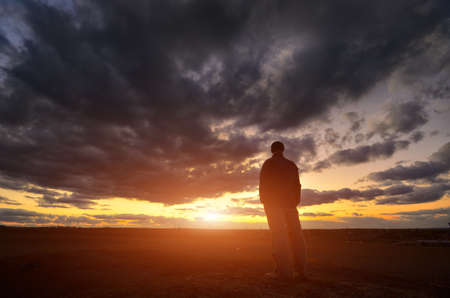 eternal: Silhouette of man at the sunset. Emotional scene.
