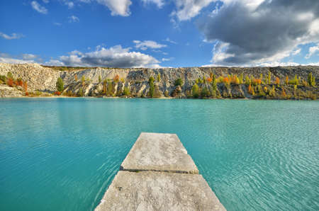 stone pier in the lake against the backdrop of the cliffs. natural composition Stock Photo - 11143554