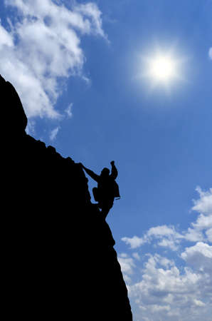 reaches: man on top of the mountain reaches for the moon
