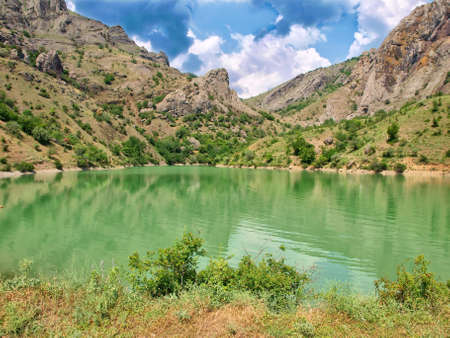 green lake in the mountains. natural composition Stock Photo - 11226077