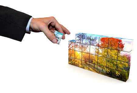 모자이크 큐브로 구성된 공원 그림의 한 부분은 양복에 남자의 손에있다