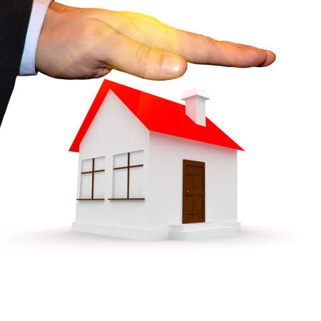 sales floor: mans hand over an apartment building Stock Photo