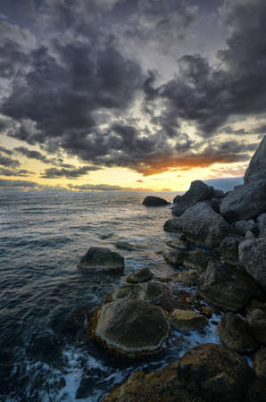 Rocks and sea. Dramatic scene. Composition of nature. photo