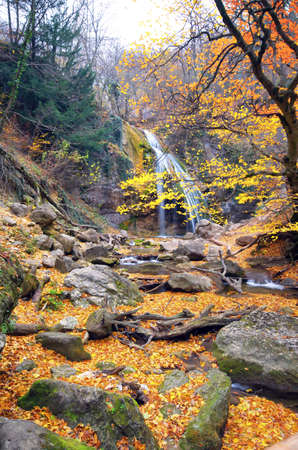 flowing waterfall on a cliff in the autumn season Stock Photo - 11260603