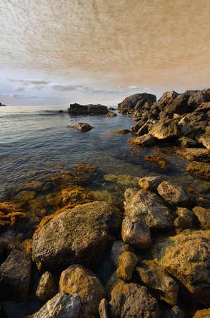 stones into the sea on sunny sky background photo
