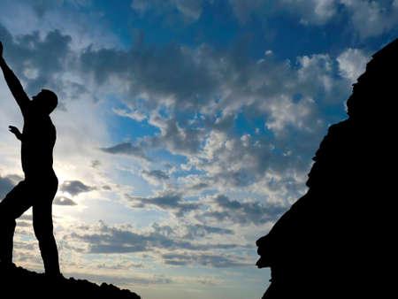 conquers: rock climber conquers mountain Stock Photo