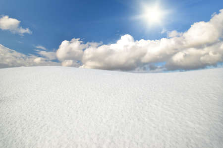 rime frost: winter landscape against the backdrop of sunny sky with clouds Stock Photo